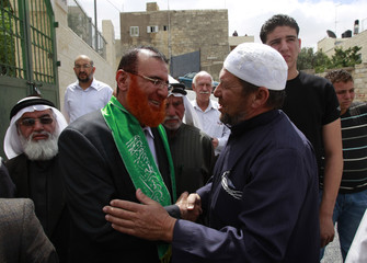 Palestinian Hamas lawmaker Mohammed Abu Tir is greeted  after his release from Israeli prison, at his house in the village of Tsur Baher