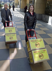 Mark Anthony Dingbaum (L), organizing manager at change.org, and Katy Butler,a one time victim of bully transport boxes containing more than 210,000 petition signatures in Los Angeles