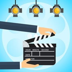 hands with clapperboard poster
