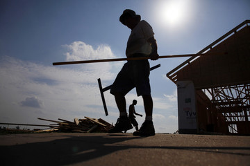 Construction workers build a home in Joplin