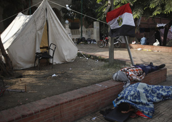 Protesters opposing Egyptian President Mohamed Mursi sleep outside the presidential palace in Cairo