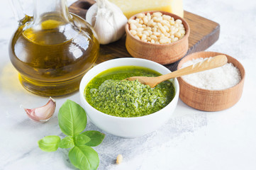 Ingredients for pesto on a white background. The finished pesto