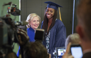 Democratic presidential candidate Clinton has her picture taken with high school graduate Roberts while campaigning at Kiki's Chicken and Waffles restaurant in Columbia