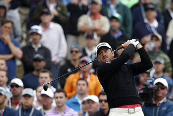 Graeme McDowell of Northern Ireland tees off on the sixth hole during the final round of the 2012 U.S. Open golf championship on the Lake Course at the Olympic Club in San Francisco