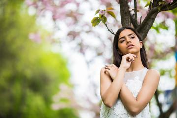 Girl with sakura tree flowers. Spring concept