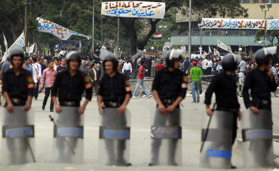 Riot police block a street to the state television building where Egyptian Christians protested against recent attacks, in Cairo