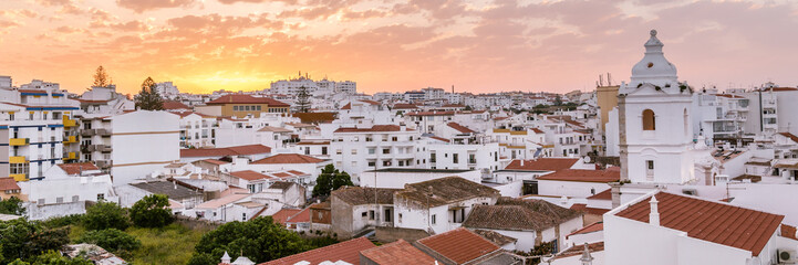 Sunrise panorama ancient town centre of Lagos, Algarve, Portugal Wall mural