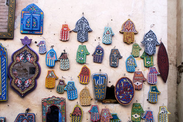 Selection of traditional Moroccan amulets, khamsa, providing defense against the evil eye, on a market in Marrakesh