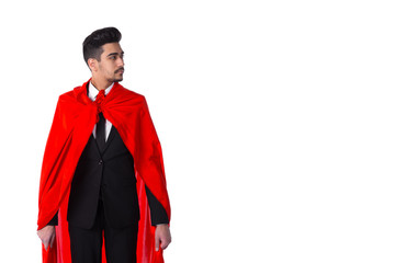 Businessman in suit and superhero red cloak