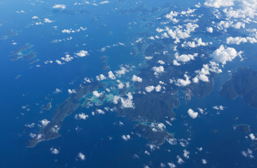 View from the wing of the aircraft to the islands of Indonesia, Matak and Mabur