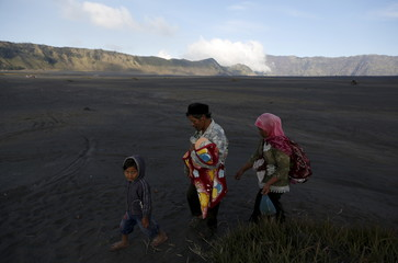 Hindu villagers walk to a temple ahead of the annual Kasada festival at Mount Bromo