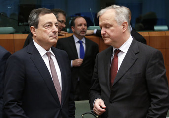 ECB President Draghi and EU Commissioner Rehn attend an eurozone finance ministers meeting in Brussels