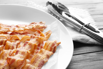 Plate with tasty bacon slices, closeup