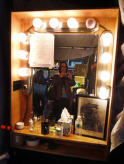 A guest takes a photograph of Bon Jovi's dressing room below the stage before his concert at the TD Garden in Boston