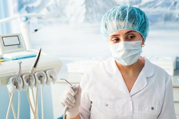 Portrait of female dentist in the medical dental office.