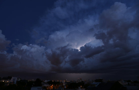 Lightning strikes behind clouds over Buenos Aires