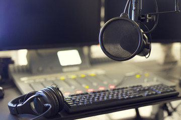 Microphone and headset in radio station broadcasting studio