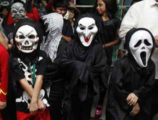 """Brainshire School students in Halloween costumes pose during their """"Halloween Day"""" in Manila"""