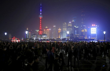 The Oriental Pearl TV Tower is lit up in blue, white and red, the colors of the French flag, following the Paris attacks, in Shanghai