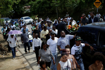 Mourners walk accompanying the coffin of Yordano Ventura, a Kansas City Royals baseball player who died in a car crash, during the funeral in Las Terrenas, Dominican Republic