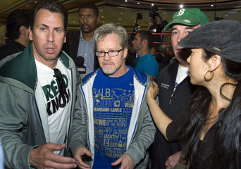 Freddie Roach makes his way through the crowd as Pacquiao arrives at the MGM Grand Hotel and Casino in Las Vegas