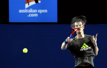 Britain's Murray hits a shot during a training session on Rod Laver Arena at Melbourne Park