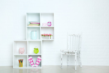 White shelves on a brick wall background