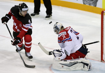 Canada's Hall challenges goaltender Pavelec of the Czech Republic during their Ice Hockey World Championship game at the O2 arena in Prague