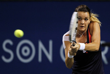 Radwanska of Poland returns a shot against Kerber of Germany during their women's singles match at the Pan Pacific Open tennis tournament in Tokyo