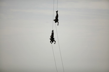 Spanish soldiers of the Marine infantry brigade rappel during a military operational exhibition in Malaga