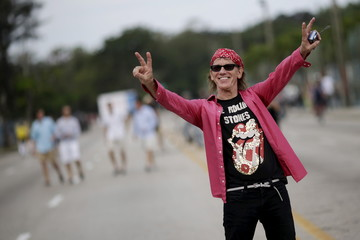 A fan reacts to the camera outside Ciudad Deportiva de la Habana sports complex where the Rolling Stones' free outdoor concert will take place today in Havana
