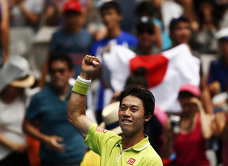 Nishikori of Japan celebrates after defeating Dodig of Croatia in their men's singles second round match at the Australian Open 2015 tennis tournament in Melbourne