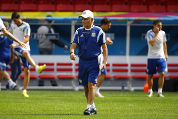 Argentina coach Alejandro Sabella walks among his players during a team training session at the national stadium in Brasilia