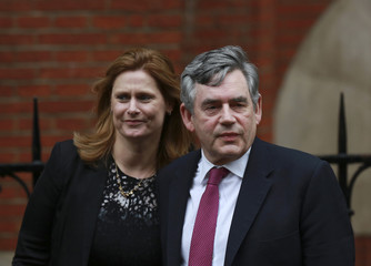Former British Prime Minister Gordon Brown arrives to give evidence before the Leveson Inquiry into the ethics and practices of the media at the High Court in London