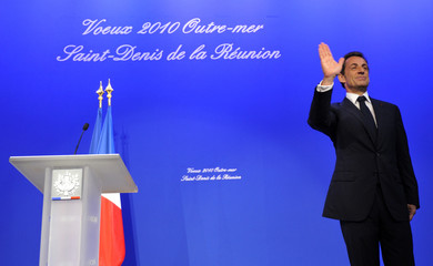 France's President Nicolas Sarkozy waves after delivering a speech during a New Year wishes ceremony in Saint Pierre on the French overseas territory of La Reunion