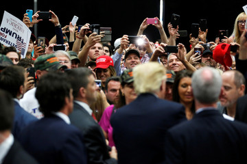 Republican U.S. presidential candidate Donald Trump signs autographs after a rally with supporters in San Diego