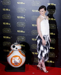 """Cast member Ridley poses for pictures with Star Wars character BB-8 during a red carpet fan event for their upcoming movie """"Star Wars: The Force Awakens"""" in Tokyo"""