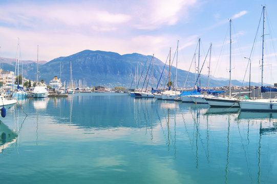 sailboats reflected on sea Kalamata port Greece