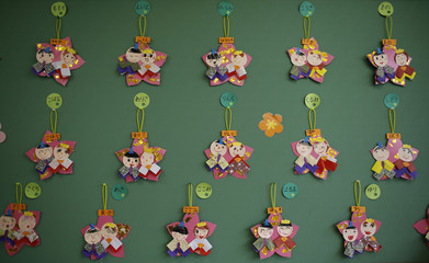 "Paper craft of Japanese ornamental ""hina"" dolls, made by children, are displayed on a wall at the Emporium kindergarten in Koriyama, west of the tsunami-crippled Fukushima Daiichi nuclear power plant, Fukushima prefecture"