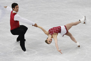 Canada's Paige Lawrence and Rudi Swiegers compete during the pairs free skating program at the ISU World Figure Skating Championships in Saitama, Japan