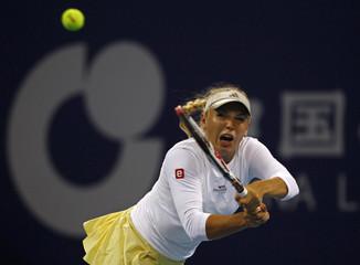 Wozniacki of Denmark hits a shot during her match against Gajdosova of Australia at the China Open tennis tournament in Beijing