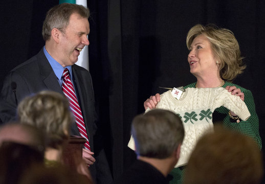 """Former U.S. Secretary of State Hillary Clinton is presented with a gift by Niall O'Dowd, publisher of the """"Irish America"""" magazine for being inducted into the Irish American Hall of Fame in New York"""