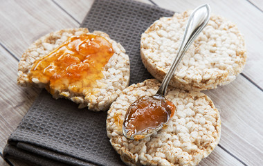 Healthy rice cake with bio jam close up