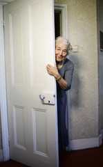 "British children's writer and illustrator Judith Kerr peers around a door as she recreates a scene from her bestselling picture book ""The Tiger Who Came To Tea"", in London"