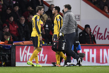Arsenal's Francis Coquelin is substituted after sustaining an injury