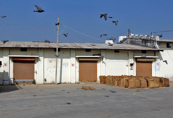 Shops selling agricultural goods are seen closed in Sanand village on the outskirts of Ahmedabad