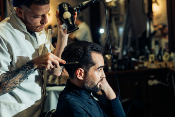 Combing of hair and styling in barber shop