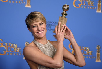 """Actress Robin Wright poses with the award for Best Actress in a TV Series, Drama for her role in """"House of Cards"""" at the 71st annual Golden Globe Awards in Beverly Hills"""