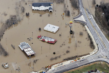 Submerged roads and houses are seen after several days of heavy rain led to flooding, in an aerial view over Union, Missouri
