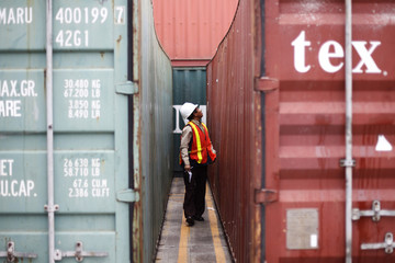An inspector looks at containers holding arms seized from a North Korean flagged ship in Colon City
